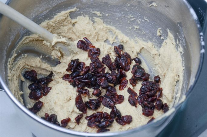 folding the cranberries into the cookie dough