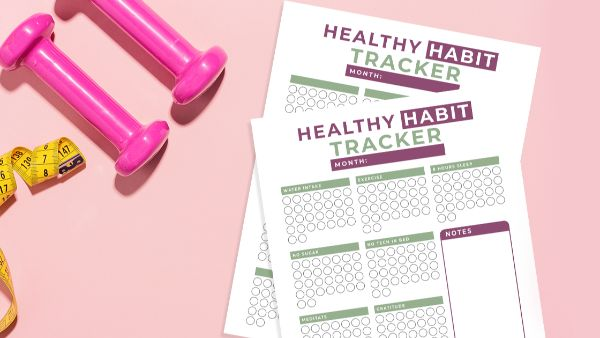 habit tracker printable on pink background with pink hand weights