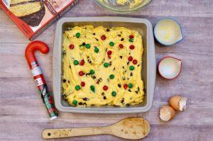 m&m cookie bar mixture in pan