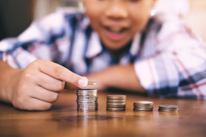 boy counting and stacking coins